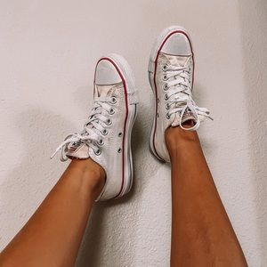 White converse tie up sneakers